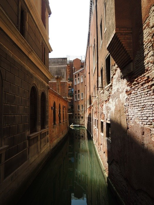 grunge old buildings at narrow channel, italy, venice