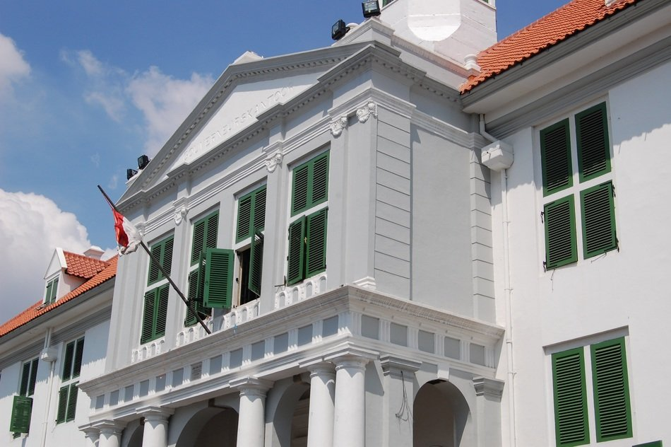old building with flag on balcony, indonesia, jakarta