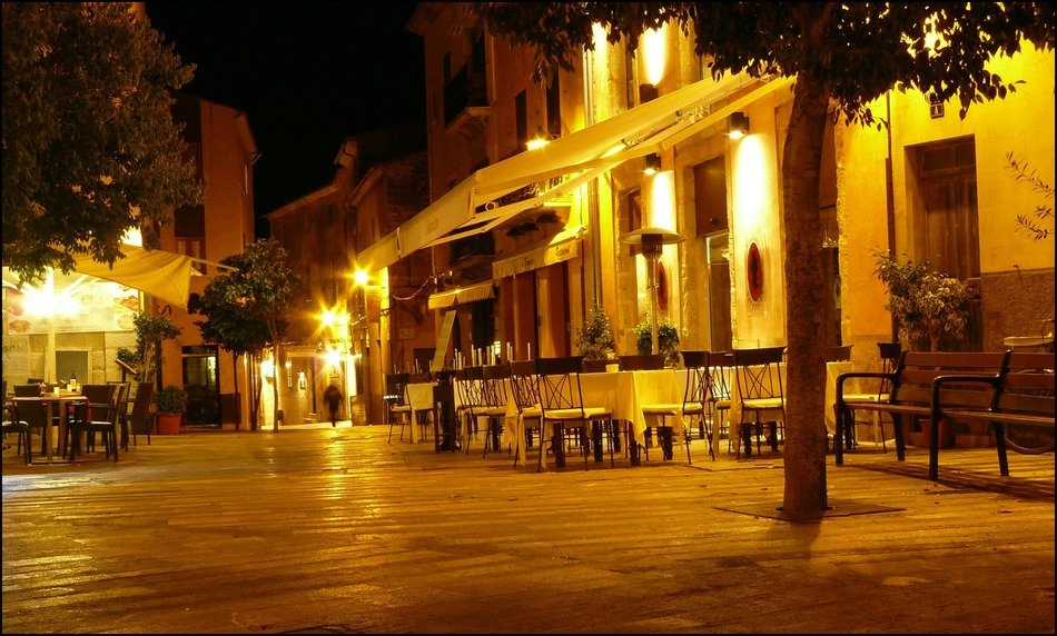 open air cafe on night street, spain, mallorca