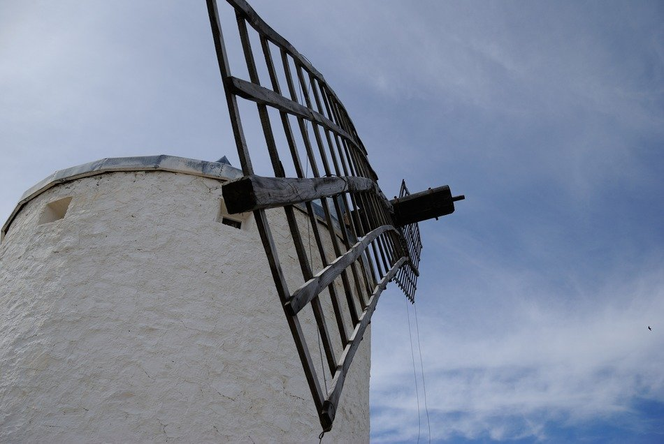 bottom view of windmill at sky