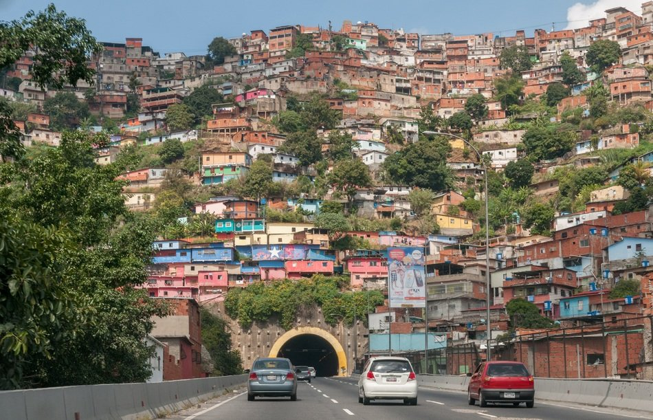 colorful house on mountain above tunnel, venezuela, barrio