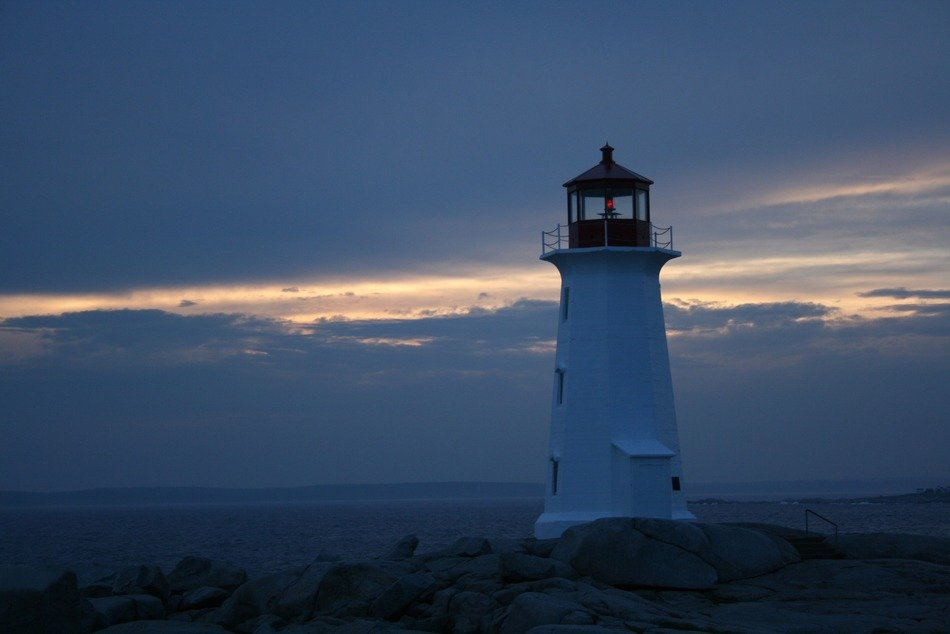 old Peggy's Point Lighthouse at evening sky, canada, nova scotia, peggy's cove
