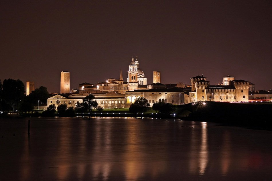 night skyline of old city at water, italy, mantova