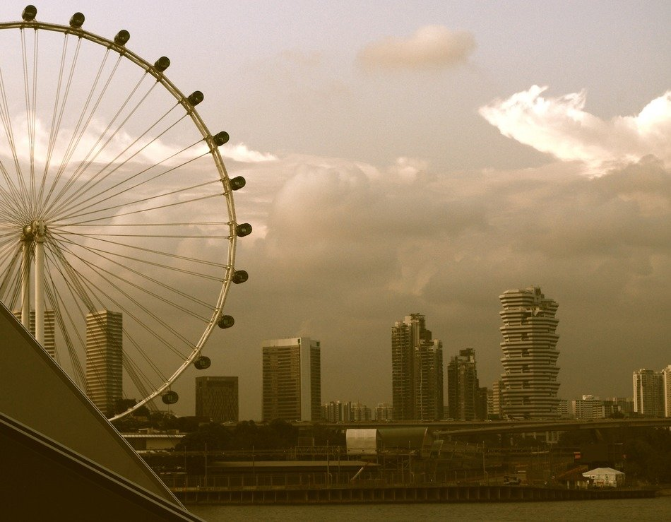 ferris wheel at evening cityscape, singapore