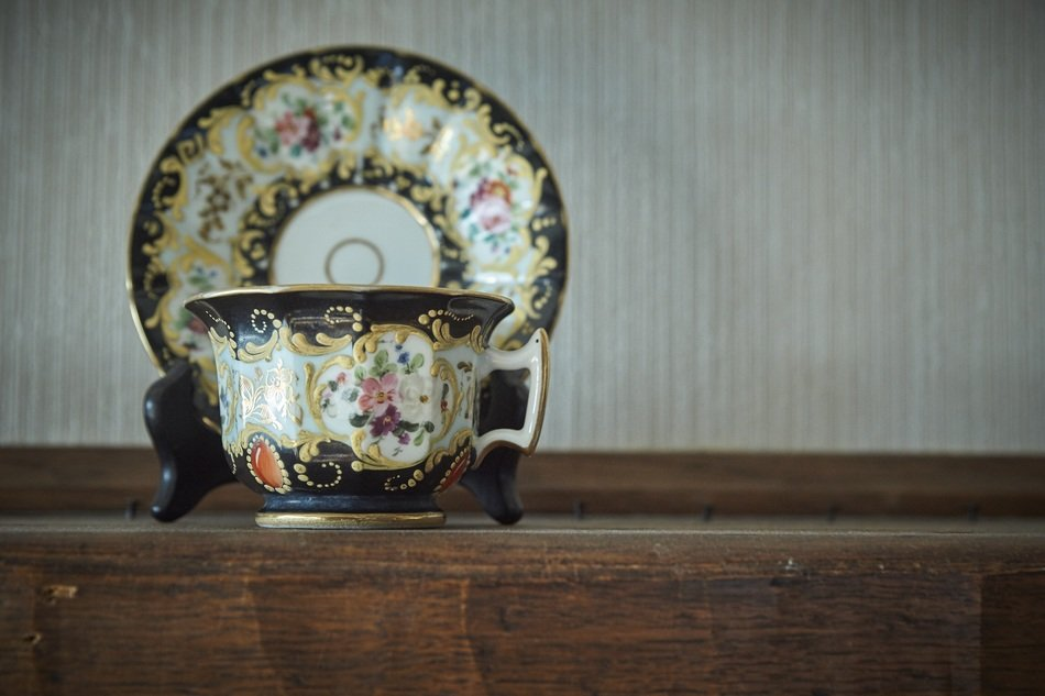 beautiful painted antique procelain teacup with saucer