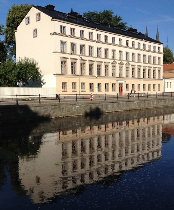old building mirroring on Fyris river, sweden, uppsala