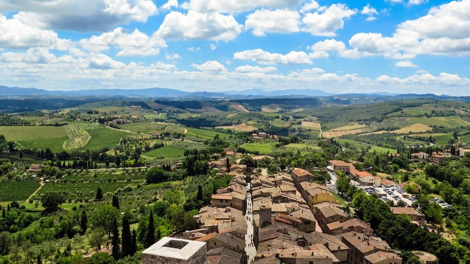 city ​​landscape on the background of clouds and sky in San Gimignano in Tuscany, Italy