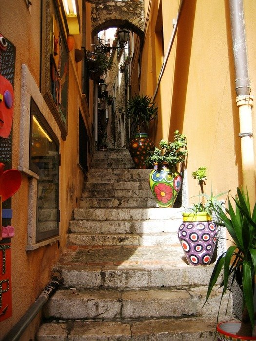 alley with potted plants on stone stairs in old town, spain, torremolinos