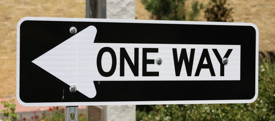 one way left direction road sign