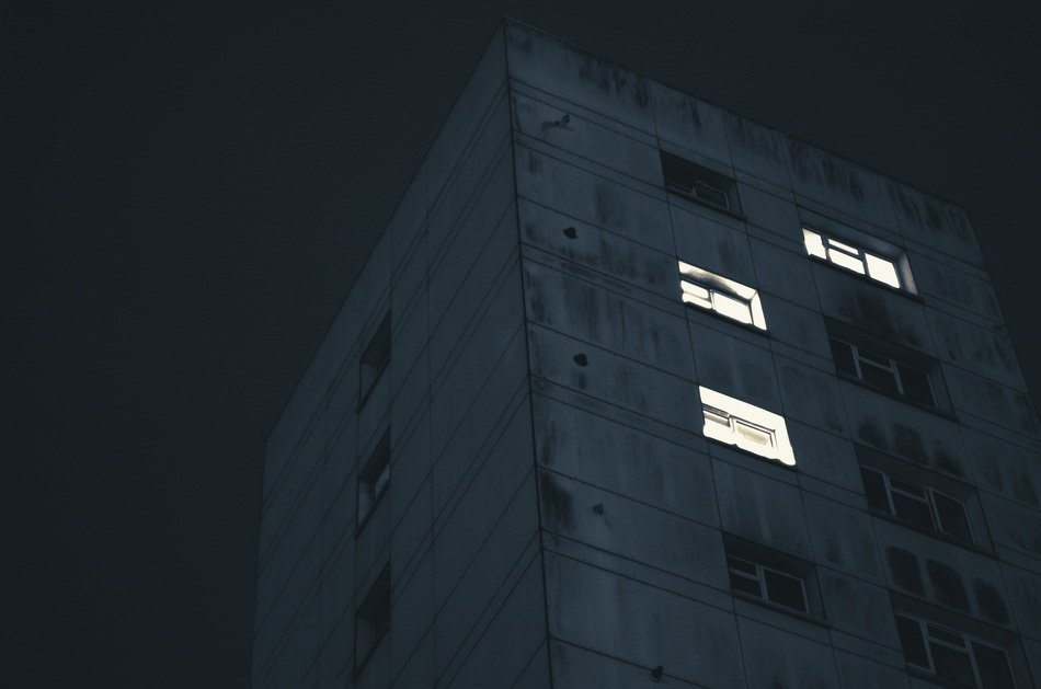 light in windows of residential building at night