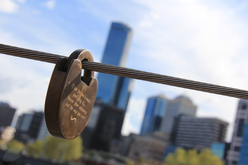 love lock on steel rope at cityscape