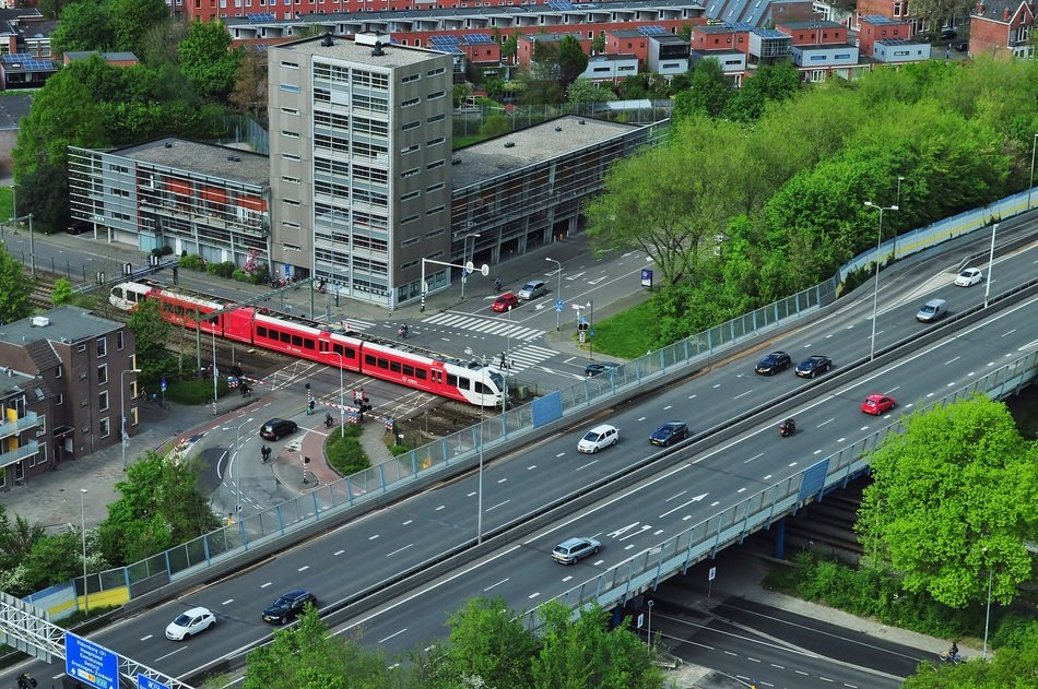 transport on overpass across rail road in city, netherlands