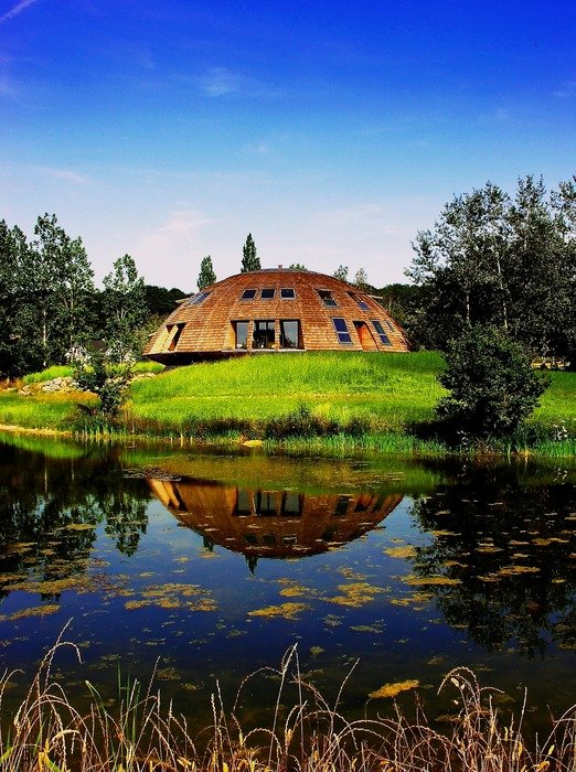 scenic countryside landscape, domed house at pond, russia