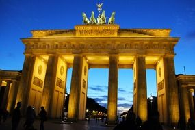 brandenburg gate on potsdamer platz at night, germany, berlin