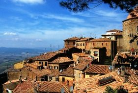 old red brick village buildings on hill, italy, tuscany