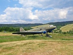 World War II Soviet fighter aircraft on meadow in summer countryside