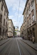 tram on railway in old city, ukraine, lviv