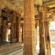 ancient carved stone pillars, india, hampi