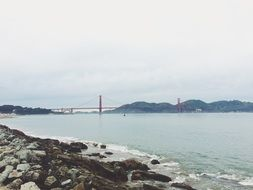 distant view of golden gate suspension bridge at coastline, usa, california, san francisco