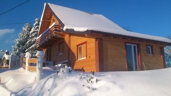 wooden house at snowy winter, croatia