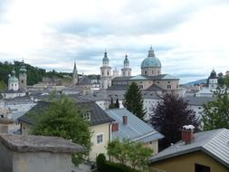 domes of cathedral among roofs of old buildings, austria, salzburg