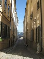 alley with cobblestone pavement in old town, sweden, stockholm, gamla stan