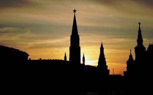 kremlin towers silhouettes at sunset sky, russia, moscow, red square