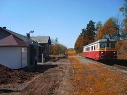 old passenger train at small station in countryside, czech republic, chvalec