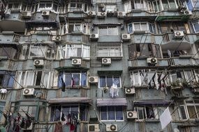 air conditioners on balconies of poor apartments, china
