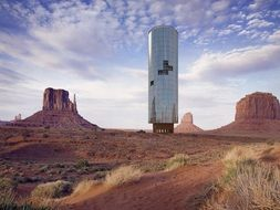 modern tower in monument valley, collage