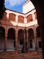 mudejar style patio with arches and columns