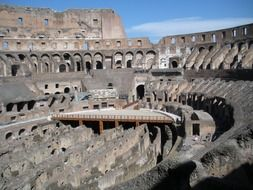 new wooden floor in interior of ancient colosseum, italy, rome