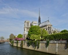view of notre dame cathedral from seine river, france, paris