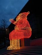 santa claus, christmas decoration on steps outdoor at dusk, germany, wolfsburg