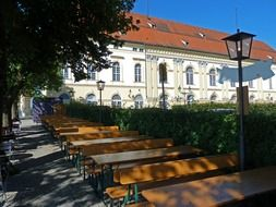 free tables in park at schloss dachau, germany, bavaria