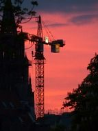 tower crane at purple evening sky