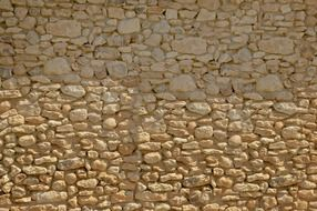 old yellow wild stone wall