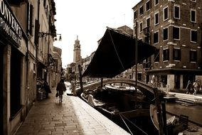 boat on channel at bridge, italy, venice