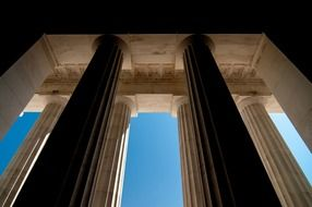 low angle view of modern stone columns at sky