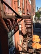 fire escape staircase on red brick facade in city