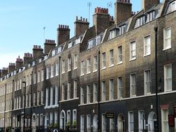 facades of old houses with chimneys on roofs, uk, england, london