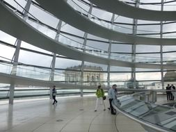people at museum exposition in glass dome of reichstag, germany, berlin