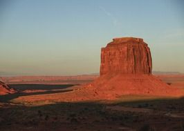 rock formation in red desert at evening, scenic landscape, usa, arizona, monument valley