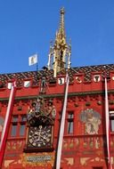antique clock on painted facade of town hall building, switzerland, basel