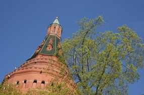 low angle view of kremlin tower at blue sky, russia, moscow