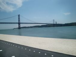 distant view of suspension bridge, portugal, lisbon