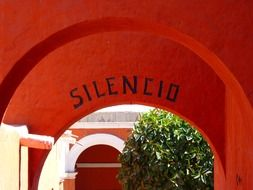 be silent, lettering on red wall of santa cathalina monastery, peru