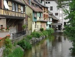 old truss buildings at river, france, alsace