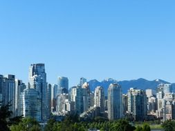 skyscrapers of modern city at mountains, canada, british columbia, vancouver