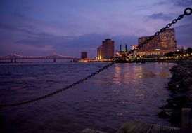 city on coast of mississippi river at dusk, usa, louisiana, new orleans